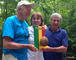 Dick Greenan, Gayle Toolin, and Peter McManus win the Rasta Race trophy.