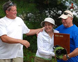 John Gibbs presents Milfoil Regatta trophy to Sally Beck and Jeff Marden