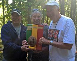 John Gibbs presents Rasta Race trophy to Dick Greenan