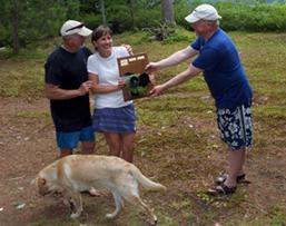 John and Lynne Gibbs accepting Milfoil Regatta trophy