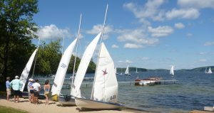 Sailboats gather at Runoia's shoreline