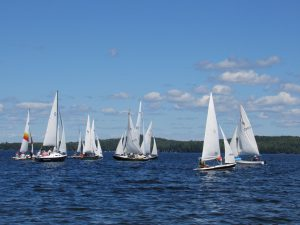 15 sailboats racing on Great Pond