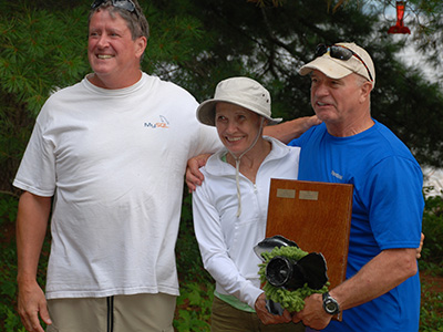 Sally Beck and crew accept the Milfoil Regatta 2014 trophy